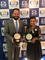 Ilkerson Maxwell Franco Santos (Balsas), e Loneide Garreto, substituta do 1º Ofício de Paço do Lumiar, com troféus do PQTA.